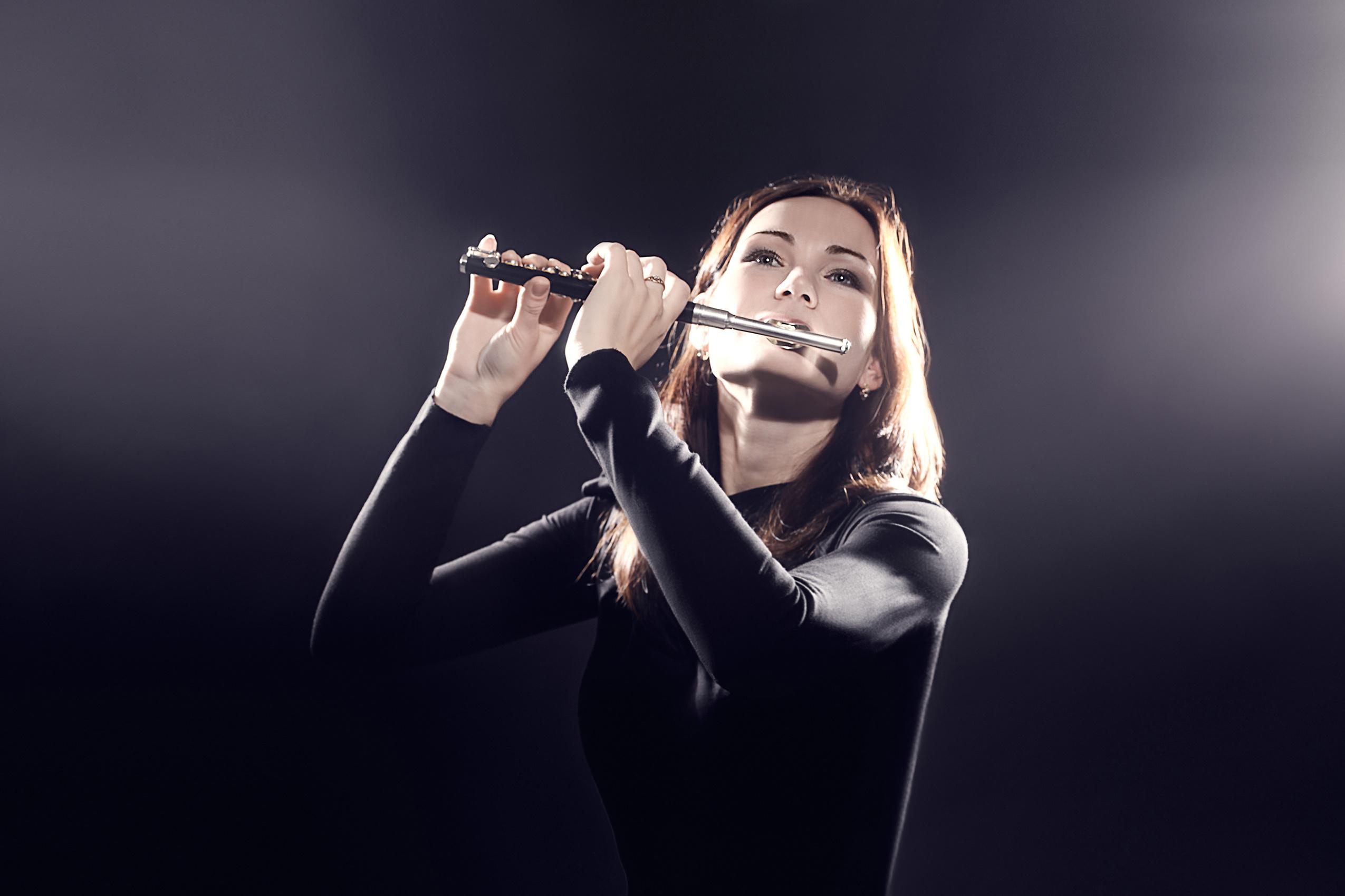 Woman playing piccolo